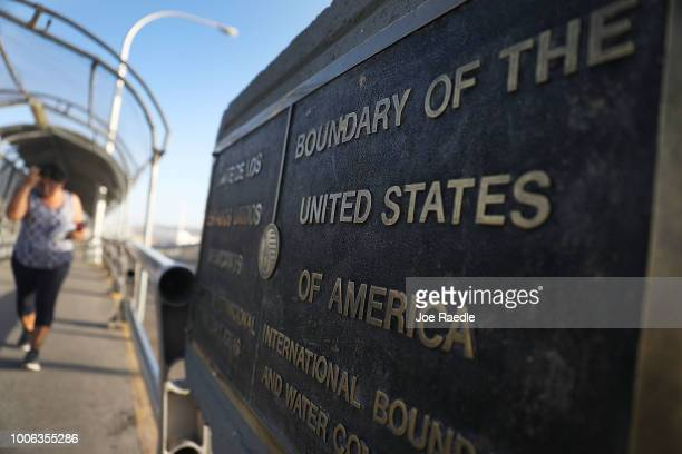 A plaque marks the US border on the Paso Del Norte Port of Entry bridge which connects the US and Mexico on July 23 2018 in El Paso Texas A...