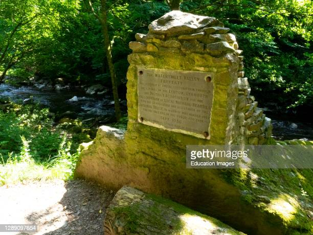 Plaque on the path between Lynmouth and Watersmeet. Plaque reads, THE WATERSMEET VALLEY PROPERTY As required by public subscription through the...