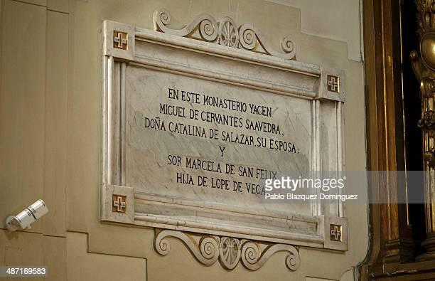 A plaque on the wall reads 'In this monastery lies Miguel de Cervantes Saavedra his wife Mrs Catalina de Salazar and Lope de Vega's daughter Sor...