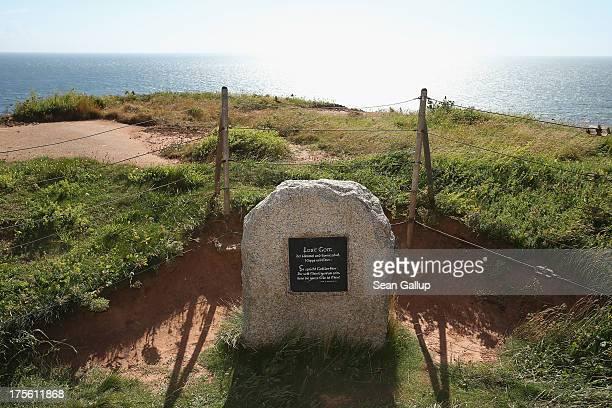 A plaque praises God along the western cliffs on August 3 2013 on Heligoland Island Germany Heligoland Island in German called Helgoland lies in the...