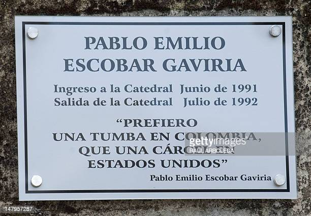 A plaque remembering late Colombian drug lord Pablo Escobar is seen at the Benedictine monks convent during the opening of the first mausoleum for...