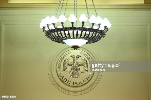 A plaque showing the coat of arms of Russia sits on display during a news conference at Russia's central bank in Moscow Russia on Friday March 23...