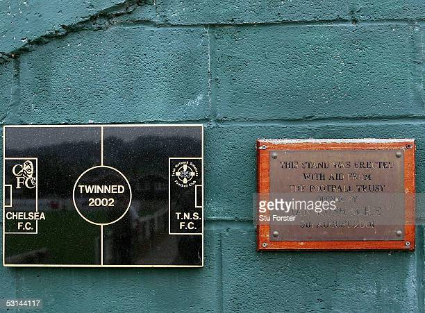 A plaque showing TNS's 'twinning' with Chelsea FC and one to commemorate the opening of the stand by Ian Rush at The Recreation Ground home of Welsh...