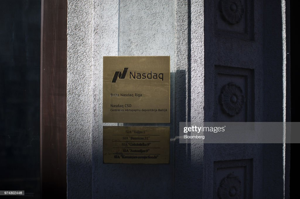 A plaque sit on display outside the Nasdaq Inc. Riga Stock Exchange in Riga, Latvia, on Thursday, June 14, 2018. Latvia's plans to kick out risky cash from its scandal-plagued banks are about to accelerate. Photographer: Jasper Juinen/Bloomberg via Getty Images