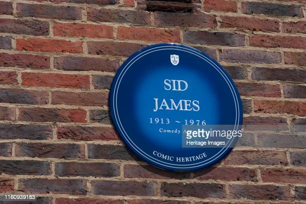 Plaque Teddington Studios Blue plaque outside Teddington Studios commemorating Sid James comedy actor one of the performers who had worked on the...