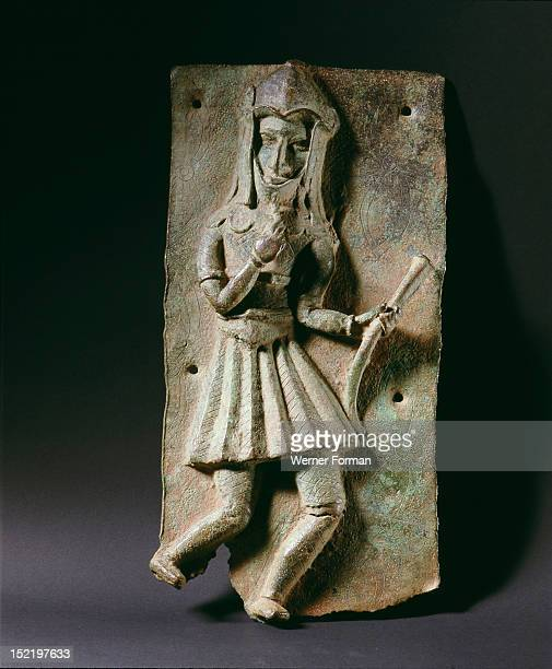 A plaque which decorated the palace of the Obas of Benin The scene depicts a helmeted Portuguese soldier armed with a matchlock Nigeria Edo late 16th...