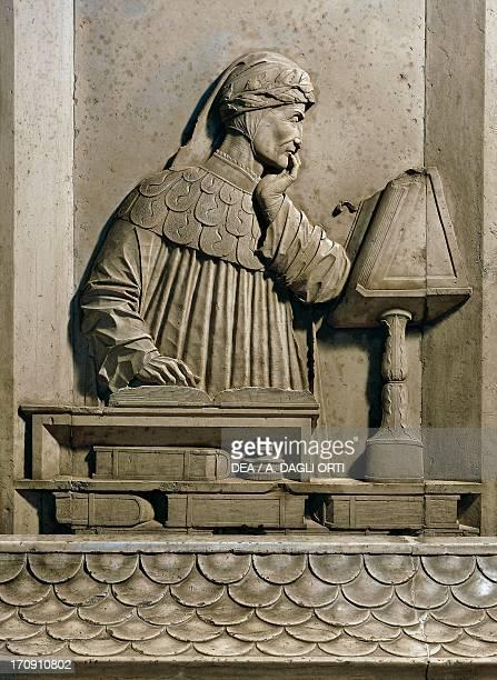 Plaque with relief depicting Dante Alighieri intent in reading by Pietro Lombardo, 15th century, tomb of Dante Alighieri Ravenna, Emilia-Romagna,...