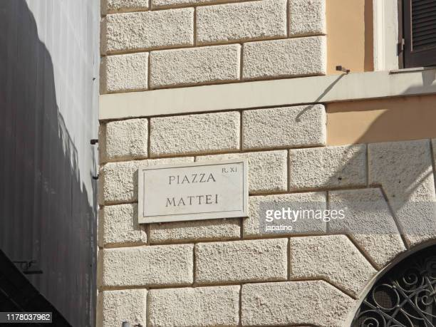 plaque with the name of the mattei square (piazza mattei) - nameplate stock pictures, royalty-free photos & images