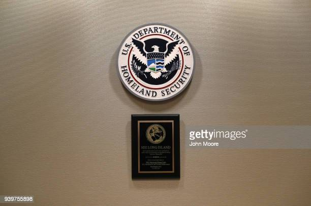 Plaques adorn the wall of the Homeland Security Investigation office during an operation targeting suspected immigrant gang members in Central Islip...