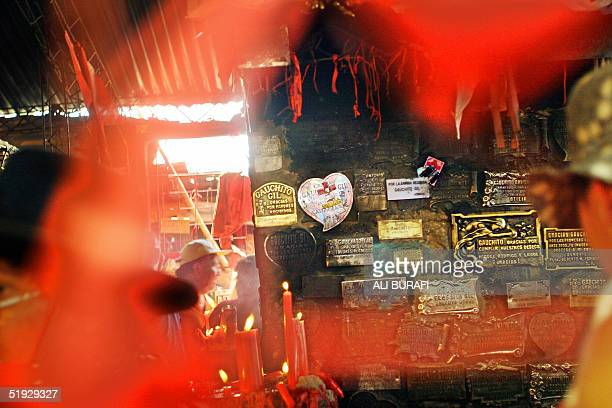 Plaques and red candles are seen at the sanctury of Gauchito Gil near Mercedes in the Argentine province of Corrientes 08 January 2005 Around 120000...