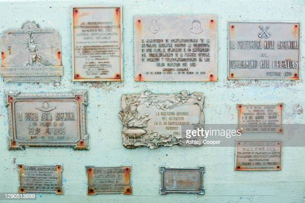 plaques at base orcadas which is an argentine scientific station in antarctica, and the oldest of the stations in antarctica still in operation. - south orkney island stock pictures, royalty-free photos & images
