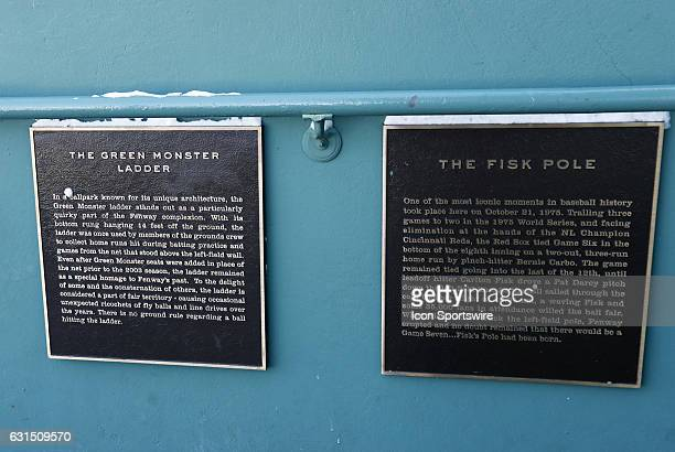 Plaques atop the Green Monster at Fenway Park before a Frozen Fenway NCAA Men's Division 1 hockey game between the Boston University Terriers and the...