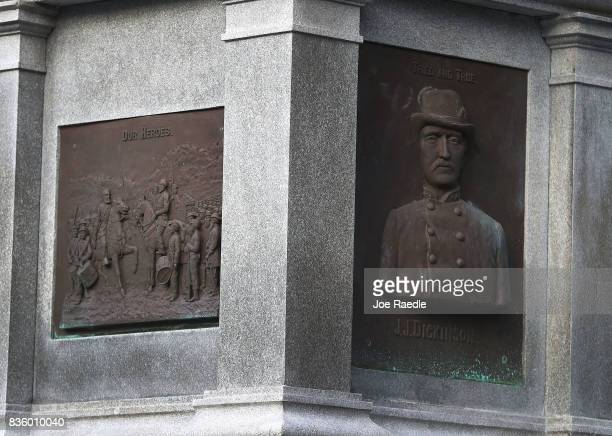 Plaques in honor of Confederates are seen on the base of a monument in Hemming Park in the midst of a national controversy over whether Confederate...