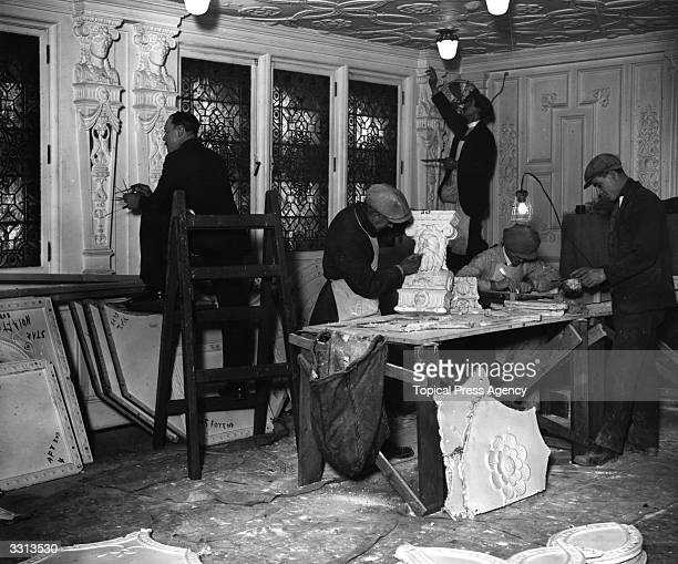 Plaster and surface decorators at work on the interior of the White Star liner 'Olympic' docked in England