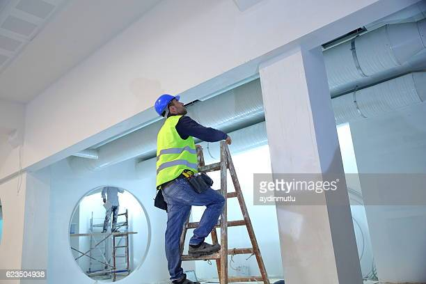plaster master - step ladder stock photos and pictures