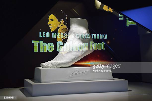 A plaster mold of the left foot of Lionel Messi is displayed at the launch of the golden statue of his foot at Harajuku Quest Hall on March 6 2013 in...