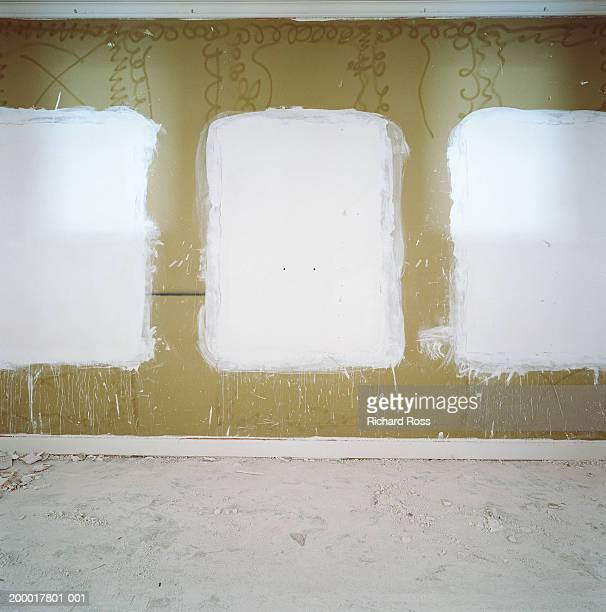 Plaster on dry wall in empty office space