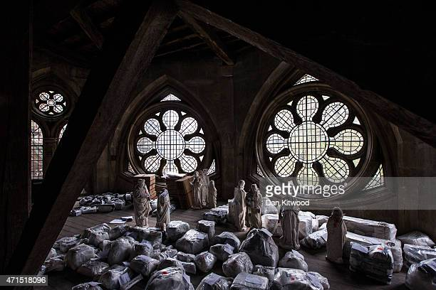 Plaster statues and other items of historical interest are stored in the Triforium awaiting removal at Westminster Abbey on April 29 2015 in London...