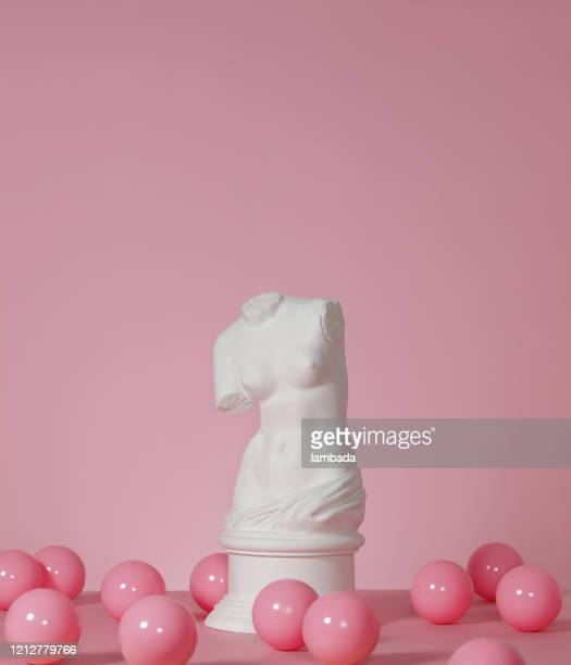 plaster torso of venus on pink background - torso stock pictures, royalty-free photos & images