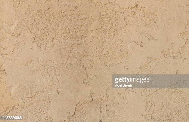 plastered concrete wall (brown colored) - stone wall bildbanksfoton och bilder