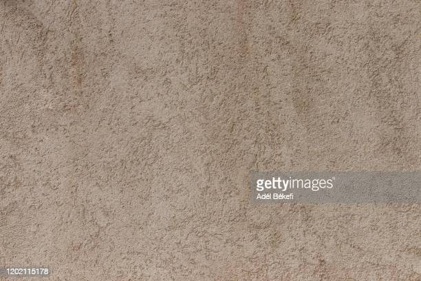 plastered concrete wall (brown colored) - beige stock-fotos und bilder