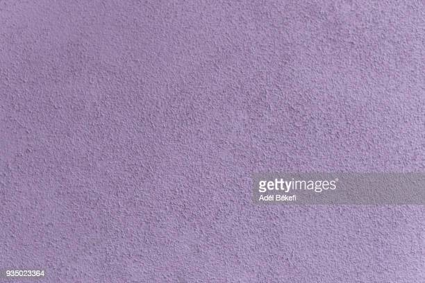 plastered concrete wall (lavender colored) - lavender color ストックフォトと画像