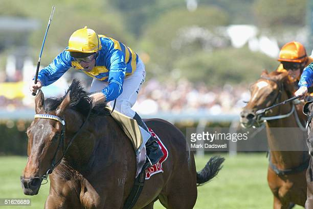 Plastered ridden by Paul Harvey wins the Victoria Deby during the AAMI Victoria Derby Day at Flemington Racecourse October 30 2004 in Melbourne...