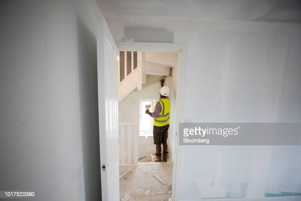 A plasterer works inside a newly built home at a Persimmon Plc residential construction site in Grays UK on Tuesday Aug 14 2018 Persimmon are due to...