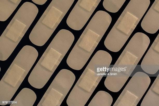 plasters - esparadrapo fotografías e imágenes de stock
