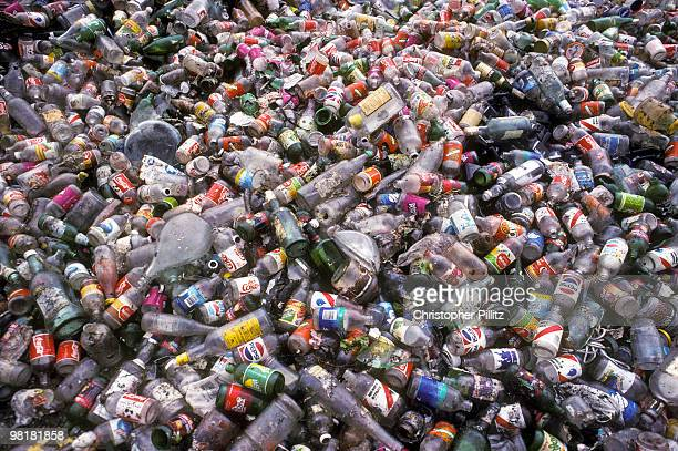 Plastic and glass bottles and other detritus on a rubbish dump in Mexico city Mexico circa 2000
