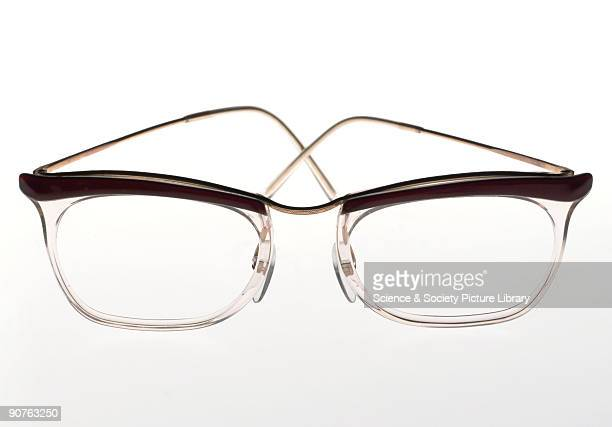 Plastic and metal framed 'Etoile' spectacles After the establishment of the UK's National Health Service in 1948 cheap spectacles became available to...