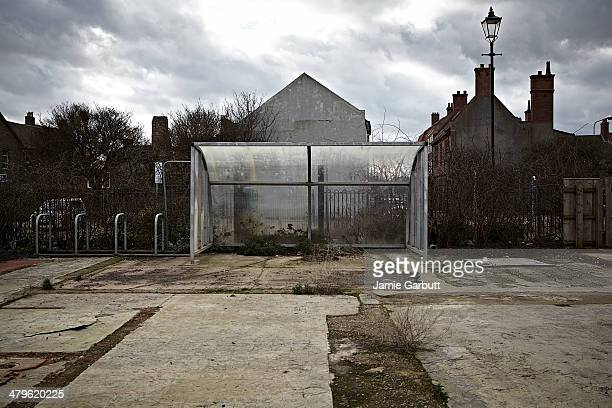 A plastic and metal goal stands on an disused land
