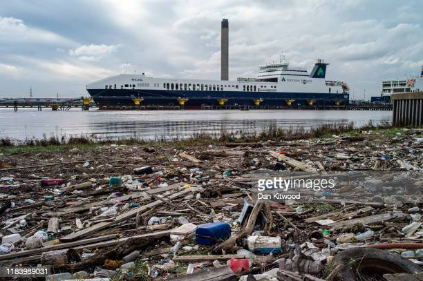 Plastic and other items of detritus are seen along the Thames shoreline near an Alternative Transport ferry is docked at Purfleet Port on October 28...