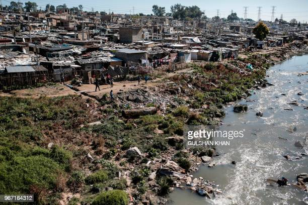 Plastic and other waste litter the Jukskei River which runs through Alexandra Township in Johannesburg on June 3 2018 The United Nations celebrate on...