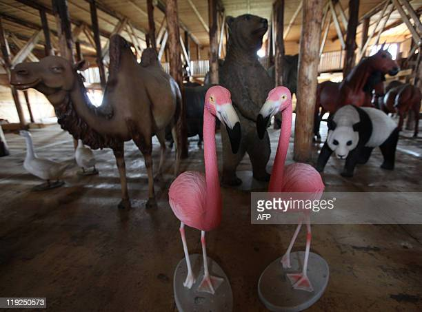 Plastic animals are seen inside the 150 metrelong Noah's ark created by Dutch Johan Huibers at an old abandoned quay on the Merwede River in...