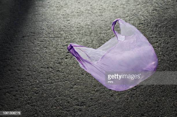 plastic bag blowing in the wind - plastic bag stock pictures, royalty-free photos & images
