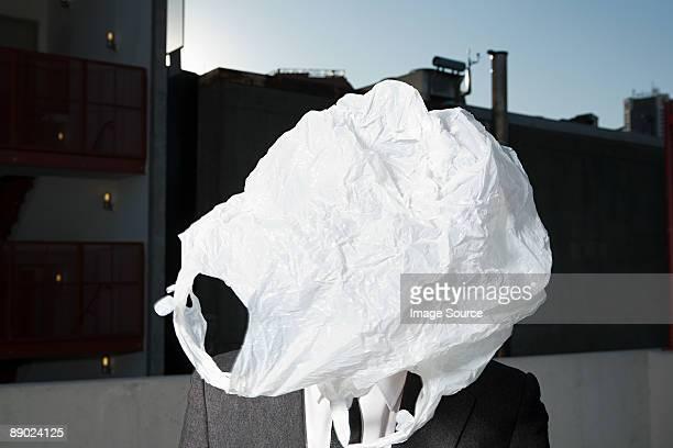 Plastic bag covering businessman's face