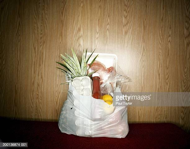Plastic bag full of groceries
