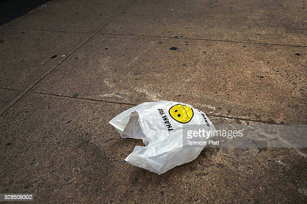 A plastic bag sits in a Manhattan street on May 05 2016 in New York City New York's City Council is scheduled to vote Thursday on a bill that would...