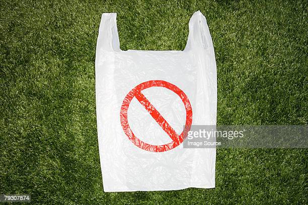 a plastic bag with a warning sign on it - plastic bag stock pictures, royalty-free photos & images