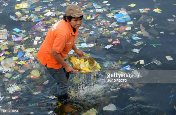 Plastic bags and other rubbish are collected from the waters of Manila Bay on July 3 2014 during a campaign by environmental activists and volunteers...