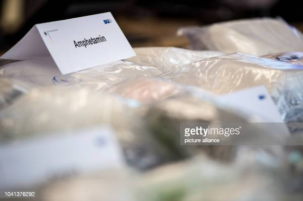 Plastic bags filled with amphetamines lie on a table at the German Federal Criminal Police Office in Wiesbaden Germany 29 February 2016 The BKA and...