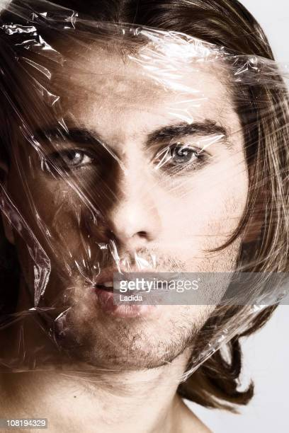 plastic beauty - man wrapped in plastic stock pictures, royalty-free photos & images