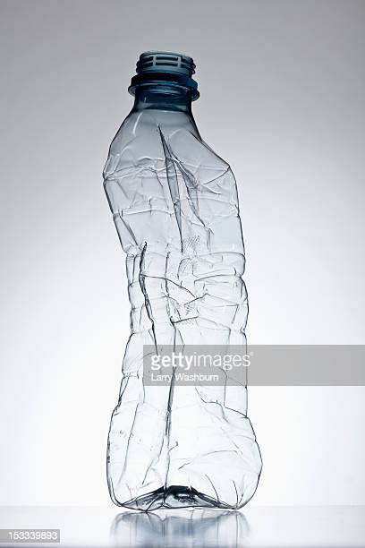 plastic bottle out of shape - crushed stock pictures, royalty-free photos & images