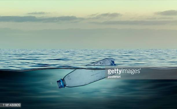plastic bottle, pollution that floats in the ocean - sea stock pictures, royalty-free photos & images