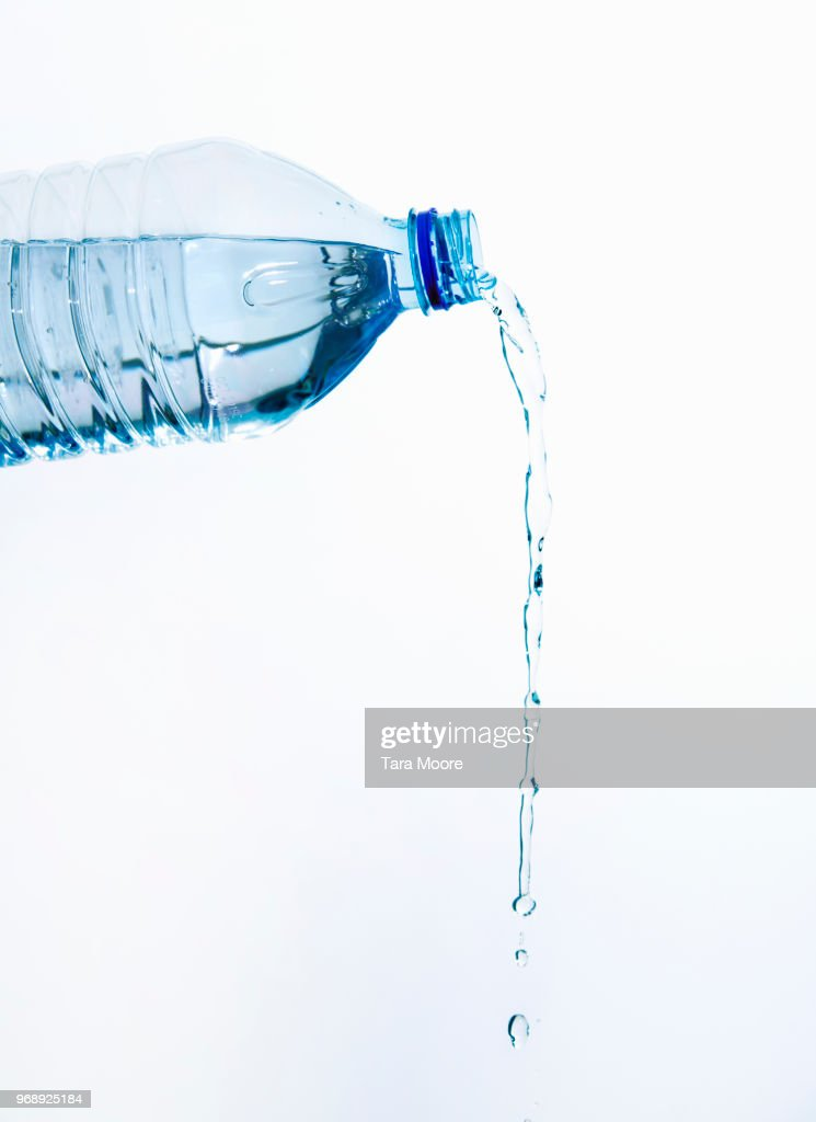 plastic bottle pouring water : Stock Photo