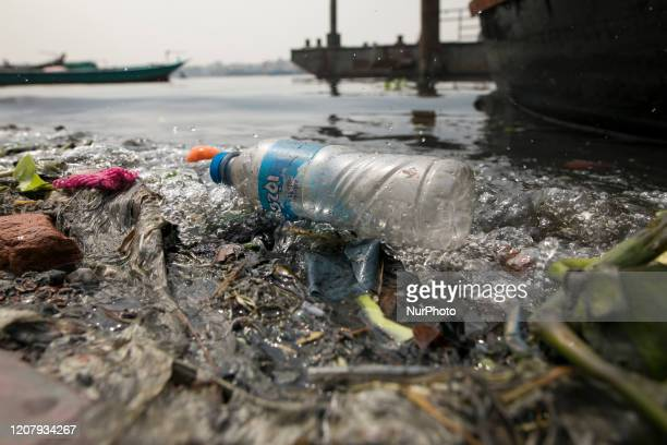 Plastic bottle seen in the Buriganga river in Dhaka Bangladesh on March 21 2020 The chemical waste of mills and factories household waste eventually...