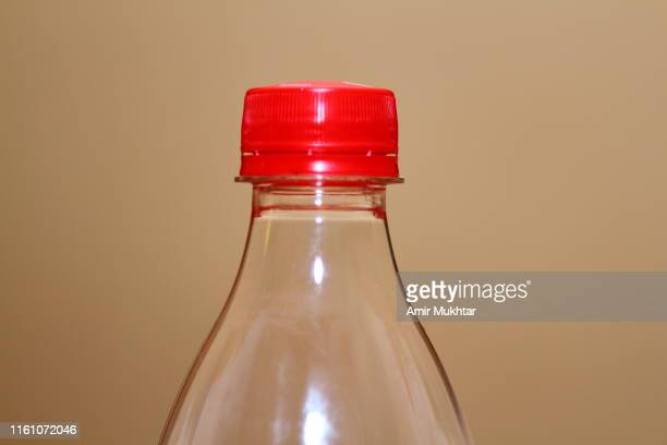 plastic bottle with cap - soda bottle stock pictures, royalty-free photos & images