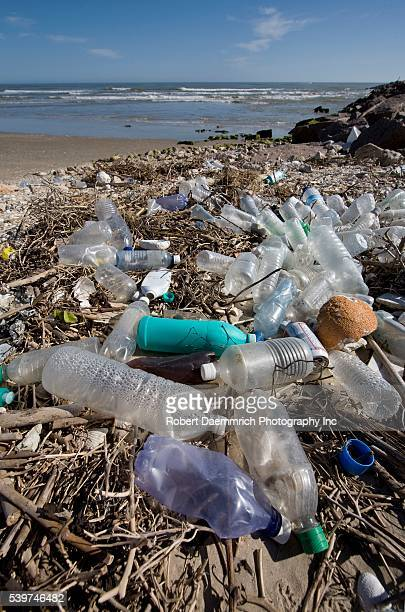 Plastic bottles and aluminum cans litter the beach and jetties where the Mansfield Cut meets the Gulf of Mexico south of Corpus Christi | Location...