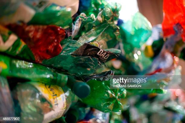 Plastic bottles and containers are put aside at the sorting centre of Parisian waste management company Syctom on August 27 in Sevran near Paris Some...